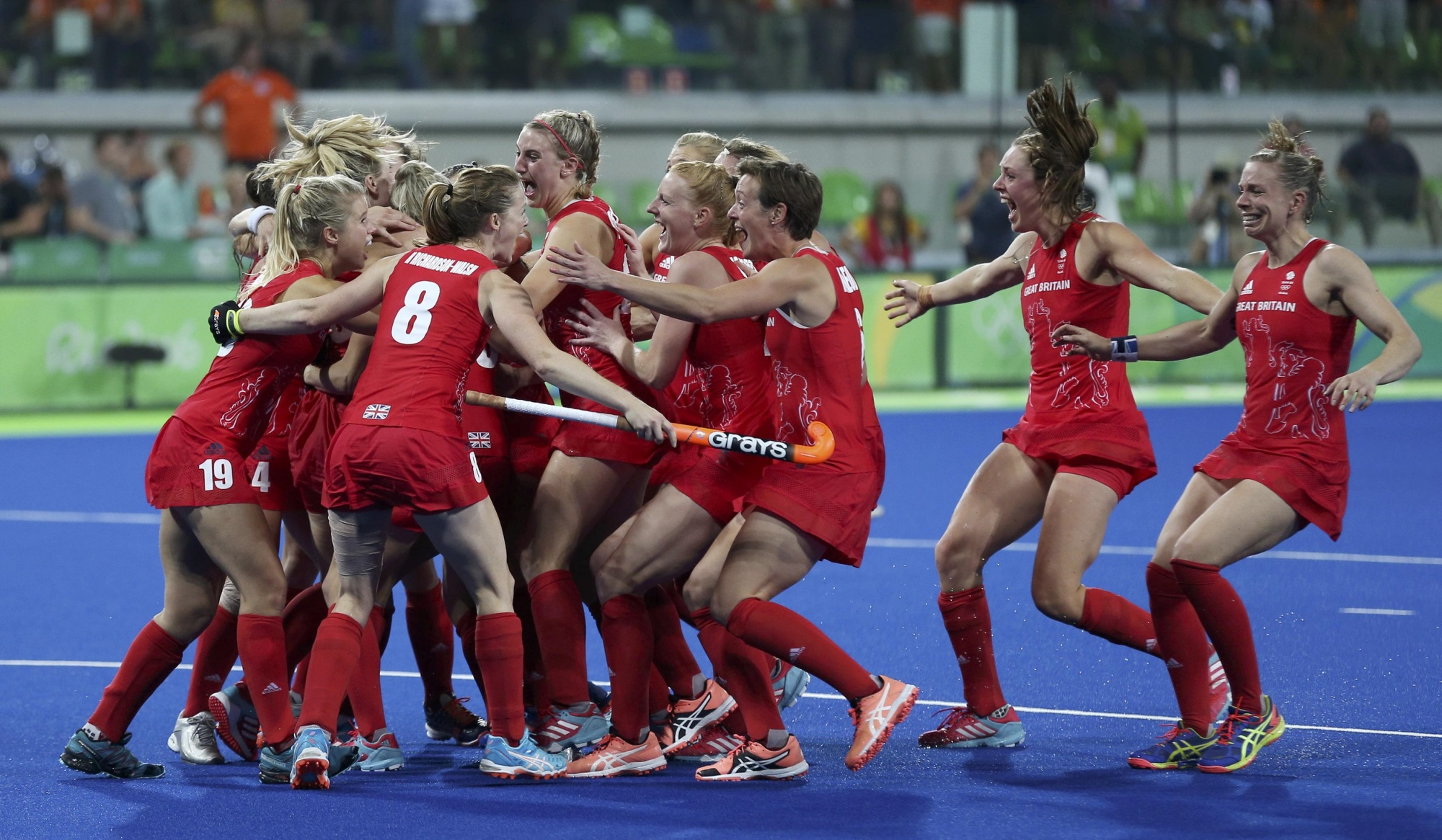 Great Britain's hockey players celebrate at the final whistle