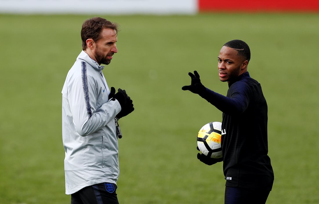 Gareth Southgate talking to Raheem Sterling
