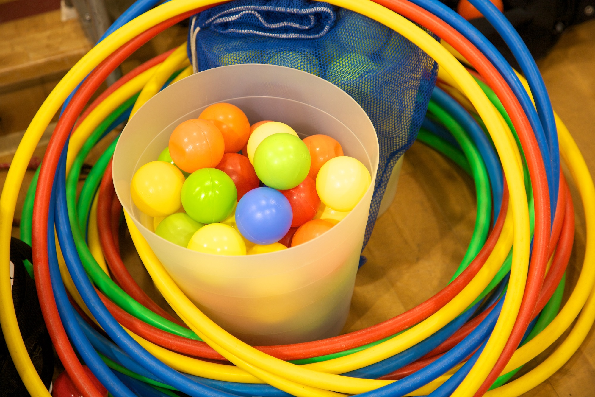 Multi-coloured plastic balls and hoops